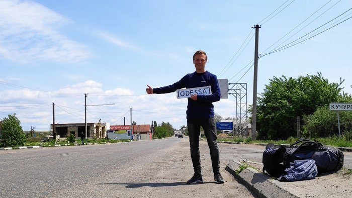hitchhiking with a sign